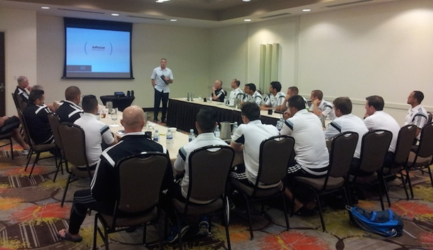 Peter Vermes giving a speech at the PRO training camp in Denver, Colorado